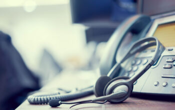 close up soft focus on headset with telephone devices at office