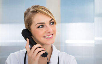 Close-up Of Happy Female Doctor Talking On Telephone